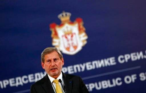 (AP Photo/Darko Vojinovic). EU Enlargement Commissioner Johannes Hahn speaks during a press conference after talks with Serbia's President Aleksandar Vucic, in Belgrade, Serbia, Wednesday, Feb. 7, 2018. Hahn says Serbia must reach an agreement on norma...