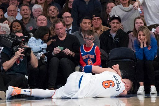 (AP Photo/Mary Altaffer). New York Knicks forward Kristaps Porzingis lies on the ground after being injured during the first half of the team's NBA basketball game against the Milwaukee Bucks, Tuesday, Feb. 6, 2018, at Madison Square Garden in New York.