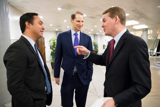 (AP Photo/J. Scott Applewhite). From left, Rep. Joaquin Castro, D-Texas, Sen. Ron Wyden, D-Ore., and Sen. Michael Bennet, D-Colo., chat as they pass in the Senate subway on Capitol Hill in Washington, Wednesday, Feb. 7, 2018.