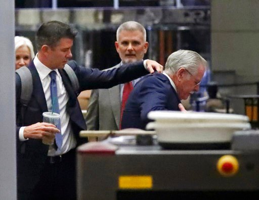 (AP Photo/Ben Margot). Former Uber CEO Travis Kalanick, left, adjusts the jacket of another man after passing through security at a federal courthouse on Wednesday, Feb. 7, 2018, in San Francisco. Kalanick took the witness stand ?Wednesday for a second...