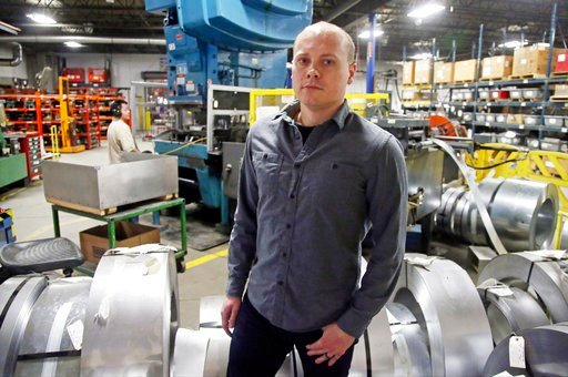 "(AP Photo/Jim Mone). Andrew Tjernlund, a co-owner of Tjernlund Products, which manufactures fans and ventilation equipment, poses for a photo at his business Wednesday, Feb. 7, 2018, in White Bear Lake, Minn. ""The tax cut allows us to invest more in ou..."