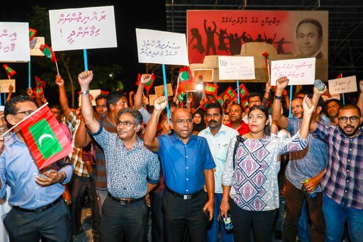 (AP Photo/ Mohamed Sharuhaan). In this late Sunday, Feb.4, 2018 photo, Maldivian opposition supporters shout slogans during a protest as they the urge the government to obey a Supreme Court order to release and retry political prisoners, including an e...