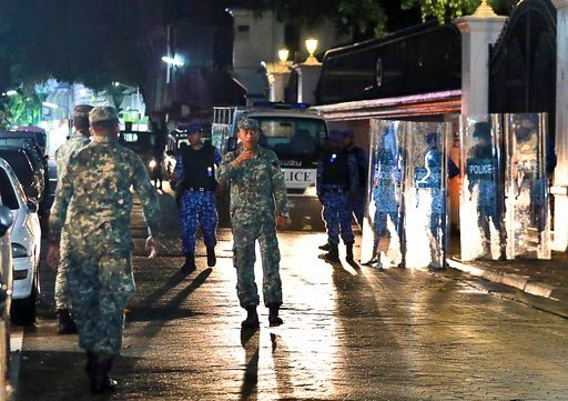 (AP Photo/ Mohamed Sharuhaan). Maldives defence soldiers patrol on the main street of Male, Maldives, Monday, Feb. 5, 2018. The Maldives government has declared a 15-day state of emergency as the political crisis deepens in the Indian Ocean nation amid...