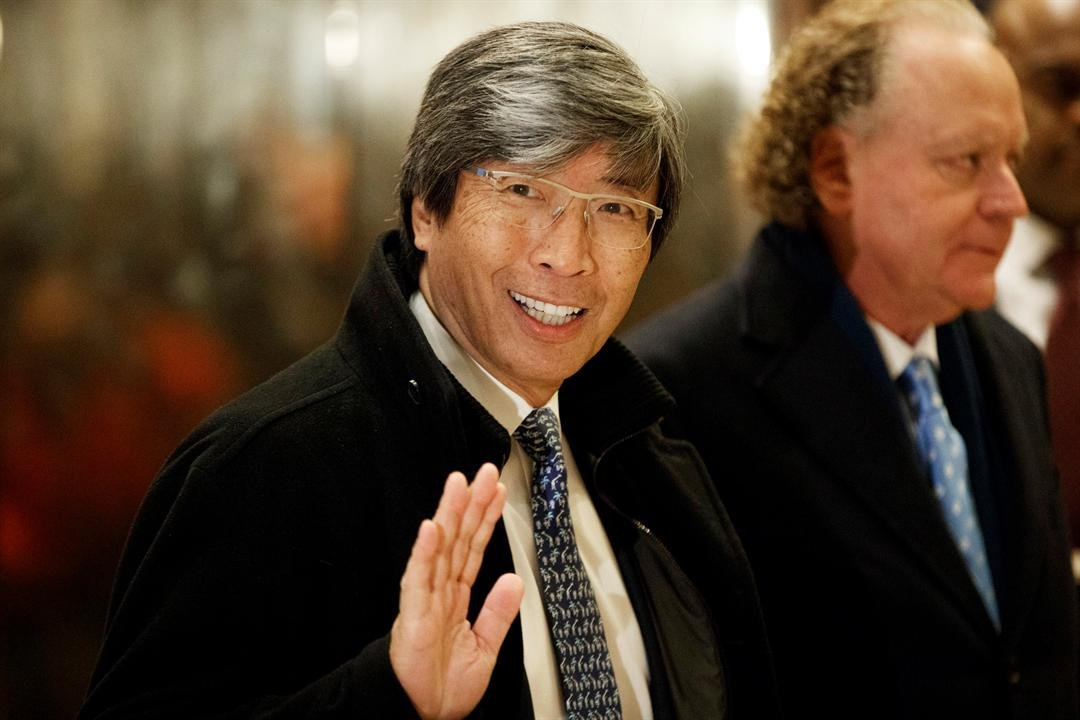 In this Jan. 10, 2017, file photo, pharmaceuticals billionaire Dr. Patrick Soon-Shiong waves as he arrives in the lobby of Trump Tower in New York for a meeting with President-elect Donald Trump. (Source: Associated Press/Evan Vucci)