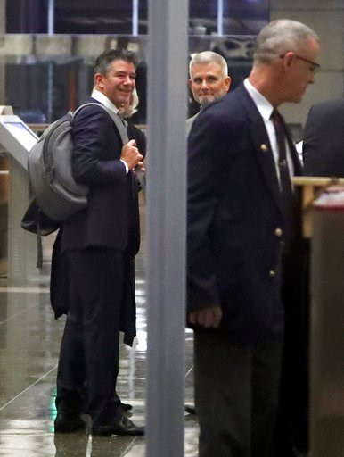 (AP Photo/Ben Margot). Former Uber CEO Travis Kalanick, left, goes through a security line upon entering a federal courthouse on Wednesday, Feb. 7, 2018, in San Francisco. Kalanick took the witness stand ?Wednesday for a second day ?offering his initia...