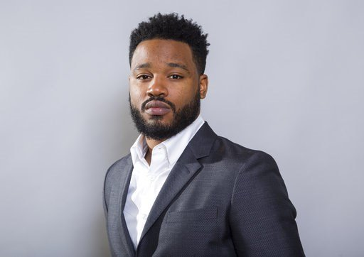 """(Photo by Willy Sanjuan/Invision/AP). In this Jan. 30, 2018 photo, filmmaker Ryan Coogler poses for a portrait at the """"Black Panther"""" press junket at the Montage Beverly Hills in Beverly Hills, Calif."""