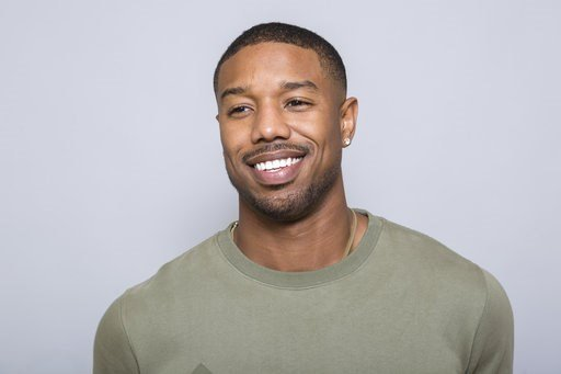 """(Photo by Willy Sanjuan/Invision/AP). In this Jan. 30, 2018 photo, Michael B. Jordan poses for a portrait at the """"Black Panther"""" press junket at the Montage Beverly Hills in Beverly Hills, Calif."""