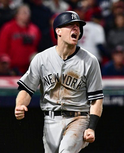 (AP Photo/David Dermer, File). FILE - In this Wednesday, Oct. 11, 2017, file photo, New York Yankees' Todd Frazier celebrates after scoring in the ninth inning against the Cleveland Indians in Game 5 of a baseball American League Division Series, in Cl...