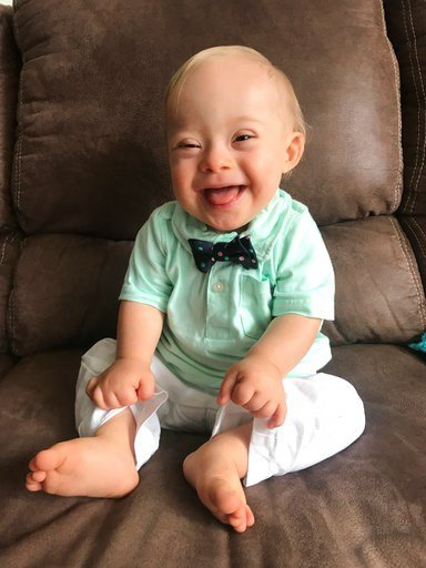 "(Courtesy Warren family/Gerber via AP). This September 2017 undated photo provided by the Warren family via Gerber shows 14-month-old Lucas Warren of Dalton, Ga. Lucas' contagious smile won over executives at Gerber baby food who have made him their ""s..."