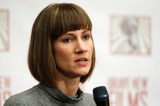 (AP Photo/Mark Lennihan, File). FILE - In this Dec. 11, 2017, file photo, Rachel Crooks, a university administrator and former Trump Tower receptionist, discusses her sexual misconduct accusations against Donald Trump during a news conference with two ...