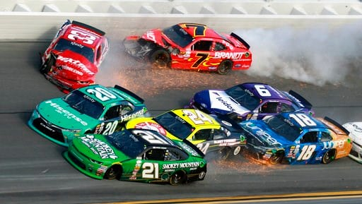 (AP Photo/John Chilton, File). FILE - In this Feb. 25, 2017, file photo, Daniel Hemric (21), Erik Jones (20), Brandon Jones (33), Scott Lagasse Jr (24), Justin Allgaier (7), Darrell Wallace Jr (6) and Daniel Suarez (18) crash during a NASCAR Xfinity se...