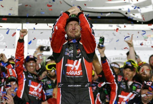 (AP Photo/Chuck Burton, File). FILE - In this Feb. 26, 2017, file photo, Kurt Busch celebrates in Victory Lane after winning the NASCAR Daytona 500 auto race at Daytona International Speedway in Daytona Beach, Fla. NASCAR goes back to work this week re...