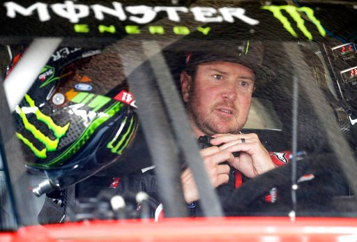 (AP Photo/Terry Renna, File). FILE - In this Feb. 18, 2017, file photo, Kurt Busch sits behind the wheel as he prepares for NASCAR auto racing practice at Daytona International Speedway in Daytona Beach, Fla. It's the second season of Monster's entitle...