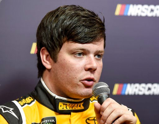 (AP Photo/Mike McCarn, File). FILE - In this Jan. 23, 2018, file photo, Erik Jones answers questions from reporters during the NASCAR Media Tour in Charlotte, N.C. Erik Jones was pulled from Furniture Row in-house to Joe Gibbs Racing. To make room for ...
