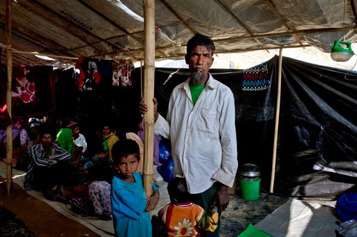 "(AP Photo/Manish Swarup). In this Monday, Jan. 15, 2018, photo, newly arrived Rohingya refugee Mohammad Ilyas, 55, stands in a makeshift transit shelter at the Nayapara camp near Cox's Bazar, Bangladesh. ""They are taking away our paddies, rice, and eve..."