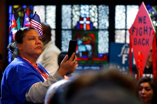 (AP Photo/Jacquelyn Martin). A woman wears flags from across the Americas in her hair as she attends a rally in support of the Deferred Action for Childhood Arrivals (DACA) program Wednesday, Feb. 7, 2018, at the Lutheran Church of the Reformation.