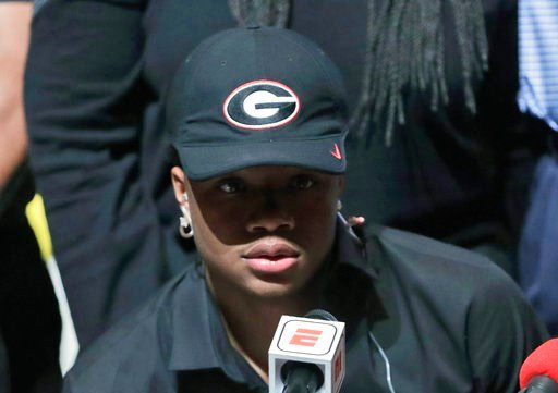(AP Photo/Lynne Sladky). Tyson Campbell, a defensive back from the football team at American Heritage High School, announces he is signing with Georgia on national signing day, Wednesday, Feb. 7, 2018, in Plantation, Fla.