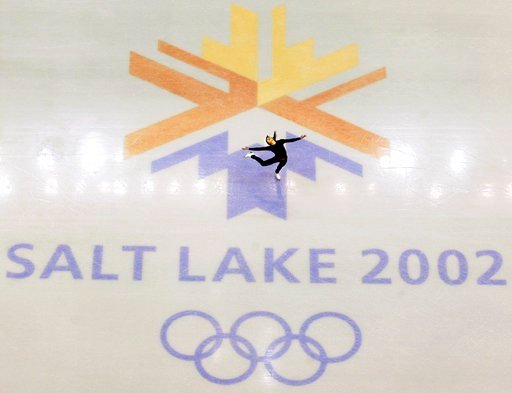 (AP Photo/Doug Mills, File). FILE - This Feb. 8, 2002, file photo shows U.S. champion Michelle Kwan practicing for the women's short program for the Winter Olympic Games in Salt Lake City at the Salt lake Ice Center. Salt Lake City has become the first...