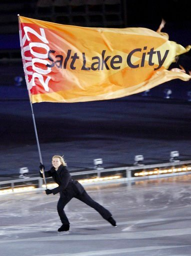 (AP Photo/Kevork Djansezian, file). FILE--In this Feb. 8, 2002, file photo, the Salt Lake City Olympic flag is skated into the Rice-Eccles Olympic stadium during the opening ceremonies of the 2002 Winter Olympics in Salt Lake City. Salt Lake City has b...