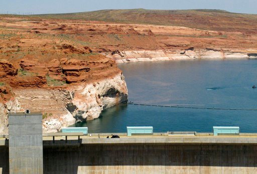 (AP Photo/Felicia Fonseca, File). FILE - This June 21, 2015 file photo shows Lake Powell behind Glen Canyon Dam near Page, Ariz. Forecasters say one of the most important reservoirs in the Southwestern U.S. will likely collect less than half its normal...