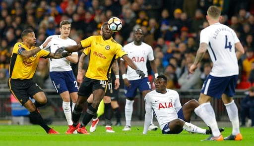 (AP Photo/Alastair Grant). Newport's Frank Nouble, No 10, at centre, looks to control the ball during the English FA Cup fourth round replay soccer match between Tottenham Hotspur and Newport County at Wembley stadium in London, Wednesday, Feb. 7, 2018.
