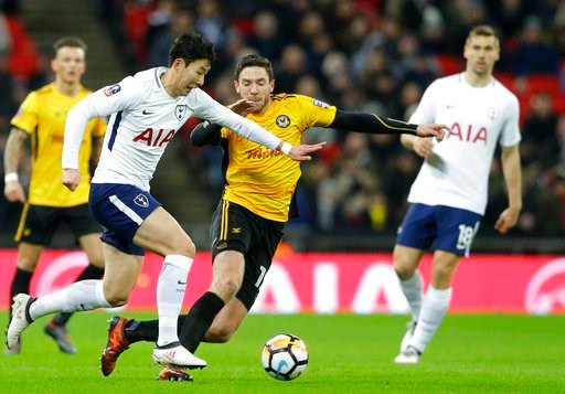 (AP Photo/Alastair Grant). Tottenham's Son Heung-min, left vies for the ball with Newport's Robbie Willmott during the English FA Cup fourth round replay soccer match between Tottenham Hotspur and Newport County at Wembley stadium in London, Wednesday,...