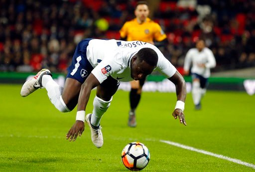 (AP Photo/Frank Augstein). Tottenham's Moussa Sissoko jumps for the ball during the English FA Cup fourth round replay soccer match between Tottenham Hotspur and Newport County at Wembley Stadium in London, Wednesday, Feb. 7, 2018.