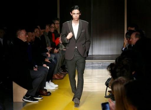 (AP Photo/Seth Wenig). A model walks the runway at a Hugo Boss fashion show during Fashion Week in New York, Wednesday, Feb. 7, 2018.