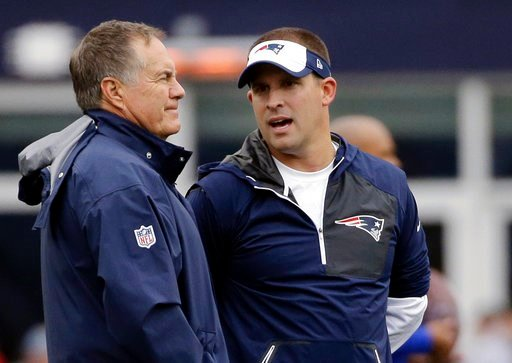 (AP Photo/Elise Amendola, File). FILE - In this Oct. 2, 2016, file photo, New England Patriots head coach Bill Belichick, left, and offensive coordinator Josh McDaniels talk before an NFL football game against the Buffalo Bills in Foxborough, Mass.  Mc...