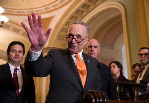 (AP Photo/J. Scott Applewhite). Senate Minority Leader Chuck Schumer, D-N.Y., flanked by Sen. Brian Schatz, D-Hawaii, left, and Sen. Bob Casey, D-Pa., speaks with reporters as work continues on a plan to keep the government open as a funding deadline a...
