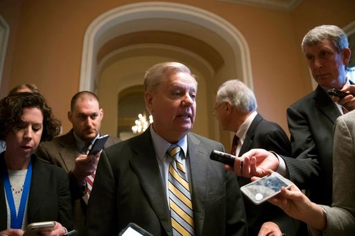 (AP Photo/J. Scott Applewhite). Sen. Lindsey Graham, R-S.C., talks to reporters at the Capitol in Washington, Wednesday, Feb. 7, 2018. Senate Judiciary Committee Chairman Charles Grassley of Iowa and Graham released a criminal referral they had sent to...