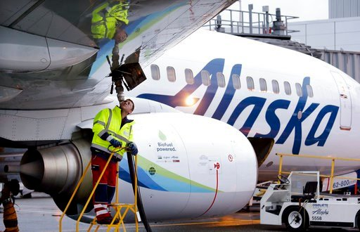(AP Photo/Elaine Thompson, File). FILE - In this Nov. 14, 2016, file photo, fueling manager Jarid Svraka looks on as he fuels an Alaska Airlines Boeing 737-800 jet at Seattle-Tacoma International Airport in SeaTac, Wash. A coalition of airlines includi...