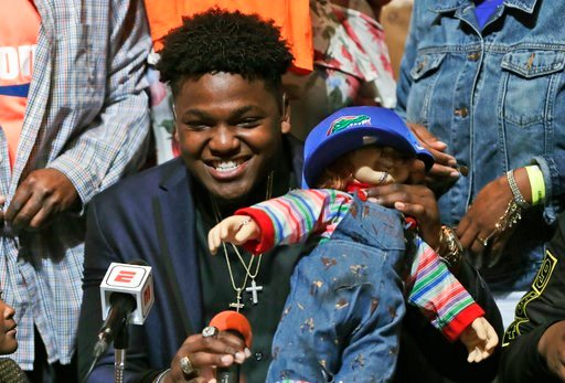 (AP Photo/Lynne Sladky). Andrew Chatfield, a defensive end from the football team at American Heritage High School, announces he is signing with Florida on national signing day, Wednesday, Feb. 7, 2018, in Plantation, Fla.