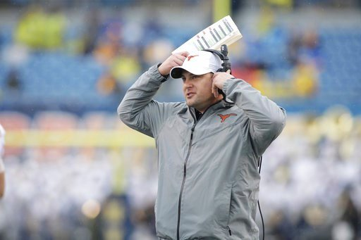 (AP Photo/Raymond Thompson, file). FILE - This Nov. 18, 2017 file photo shows Texas head coach Tom Herman watching his team from the sidelines during the first half of an NCAA college football game against West Virginia in Morgantown, W.Va. Herman and ...