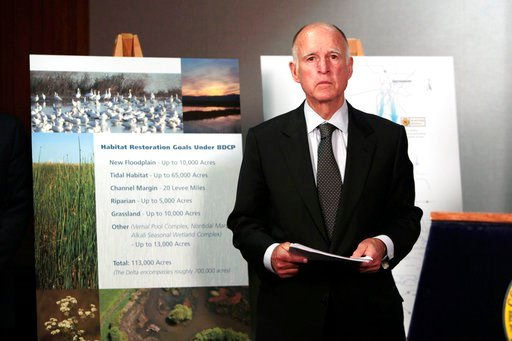 (AP Photo/Rich Pedroncelli, File). FILE - In this July 25, 2012 file photo, California Gov. Jerry Brown prepares to announce plans to build a giant twin tunnel system to move water from the Sacramento-San Joaquin River Delta to farmland and cities at a...