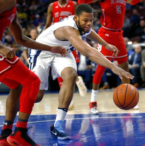 (AP Photo/Laurence Kesterson). Villanova forward Omari Spellman (14) chases a loose ball during the first half of the team's NCAA college basketball game against St. John's, Wednesday, Feb. 7, 2018, in Philadelphia.