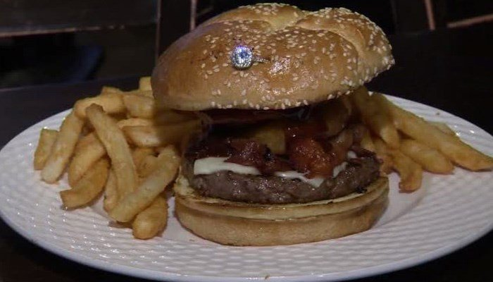 Pauli's, in the city's North End, says with 48-hours' notice, the restaurant's Big Boy burger will arrive with a 7/8 carat Neil Lane ring nestled in the bun. (Source: WCVB/CNN)