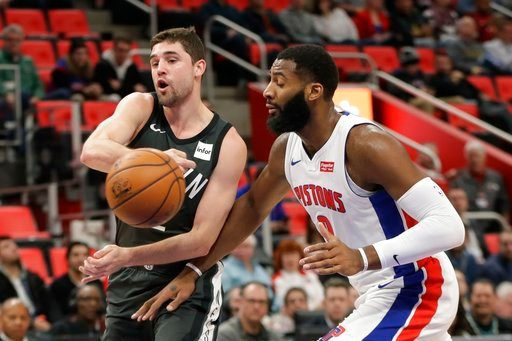 (AP Photo/Carlos Osorio). Brooklyn Nets guard Joe Harris passes the ball as Detroit Pistons center Andre Drummond (0) closes in during the first half of an NBA basketball game Wednesday, Feb. 7, 2018, in Detroit.