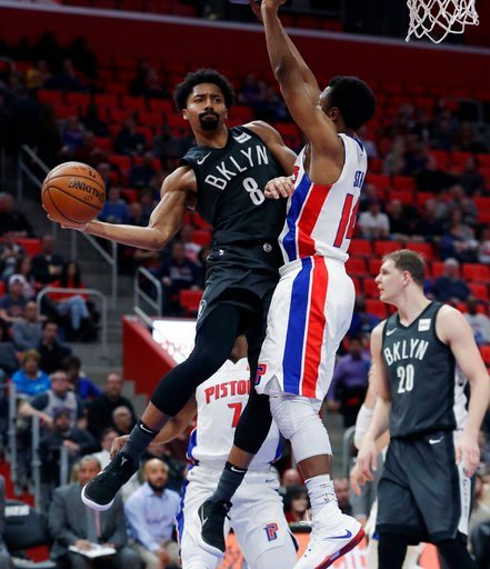 (AP Photo/Carlos Osorio). Brooklyn Nets guard Spencer Dinwiddie (8) passes the ball around Detroit Pistons guard Ish Smith (14) during the first half of an NBA basketball game Wednesday, Feb. 7, 2018, in Detroit.