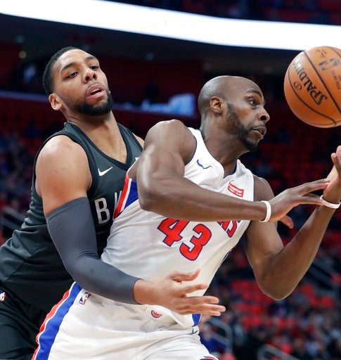 (AP Photo/Carlos Osorio). Brooklyn Nets center Jahlil Okafor knocks the ball away from Detroit Pistons forward Anthony Tolliver (43) during the first half of an NBA basketball game Wednesday, Feb. 7, 2018, in Detroit.