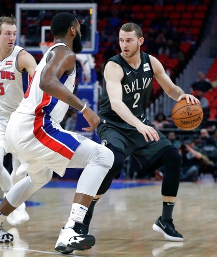 (AP Photo/Carlos Osorio). Brooklyn Nets guard Nik Stauskas (2) controls the ball as Detroit Pistons center Andre Drummond defends during the first half of an NBA basketball game Wednesday, Feb. 7, 2018, in Detroit.