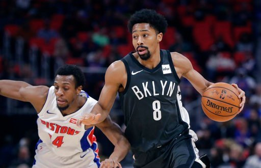 (AP Photo/Carlos Osorio). Brooklyn Nets guard Spencer Dinwiddie (8) drives around Detroit Pistons guard Ish Smith during the first half of an NBA basketball game Wednesday, Feb. 7, 2018, in Detroit.