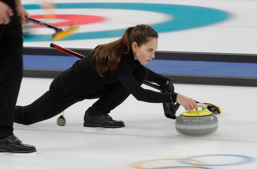 (AP Photo/Aaron Favila). Olympic Athlete from Russia curler Anastasia Bryzgalova prepares to throw her stone during the mixed doubles training session ahead of the 2018 Winter Olympics in Gangneung, South Korea, Wednesday, Feb. 7, 2018.