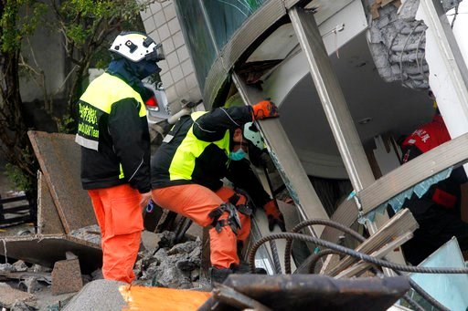(AP Photo/Chiang Ying-ying). Rescuers continue to search a collapsed apartment building following a strong earthquake in Hualien County, eastern Taiwan, Thursday, Feb. 8, 2018. A magnitude 6.4 earthquake struck late Tuesday night caused several buildin...
