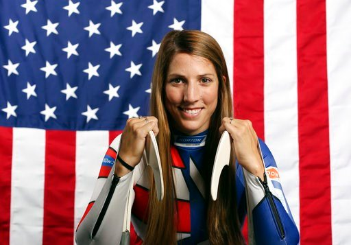 (AP Photo/Rick Bowmer, File). FILE - In this Sept. 25, 2017, file photo, United States Olympic Winter Games luge hopeful Erin Hamlin poses for a portrait at the 2017 Team USA Media Summit in Park City, Utah. Hamlin will carry the U.S. flag into Friday ...