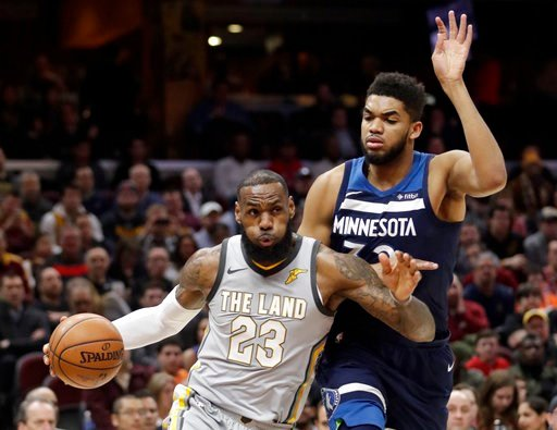 (AP Photo/Tony Dejak). Cleveland Cavaliers' LeBron James, left, drives against Minnesota Timberwolves' Karl-Anthony Towns in the first half of an NBA basketball game, Wednesday, Feb. 7, 2018, in Cleveland.