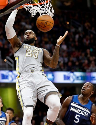 (AP Photo/Tony Dejak). Cleveland Cavaliers' LeBron James (23) dunks the ball against Minnesota Timberwolves' Gorgui Dieng (5), from Senegal, in the first half of an NBA basketball game, Wednesday, Feb. 7, 2018, in Cleveland.