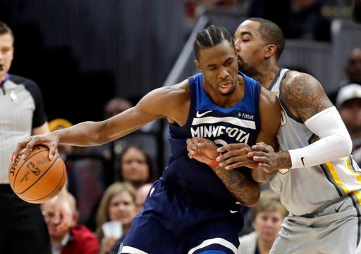 (AP Photo/Tony Dejak). Minnesota Timberwolves' Andrew Wiggins, left, drives against Cleveland Cavaliers' JR Smith in the first half of an NBA basketball game, Wednesday, Feb. 7, 2018, in Cleveland.