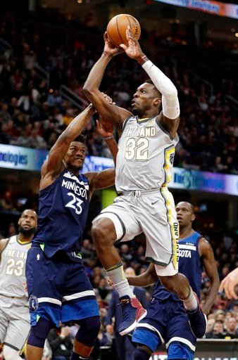 (AP Photo/Tony Dejak). Cleveland Cavaliers' Jeff Green (32) is fouled by Minnesota Timberwolves' Jimmy Butler (23) in the first half of an NBA basketball game, Wednesday, Feb. 7, 2018, in Cleveland.