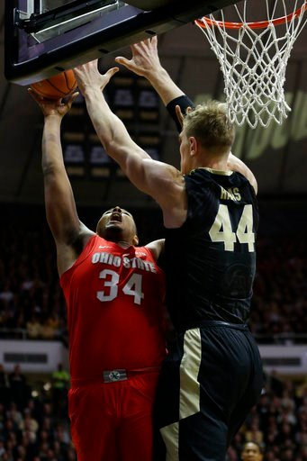 (AP Photo/AJ Mast). Ohio State forward Kaleb Wesson (34) shoots over Purdue center Isaac Haas (44)during the first half of an NCAA college basketball game in West Lafayette, Ind., Wednesday, Feb. 7, 2018.